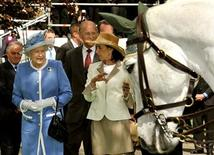 <p>Britain's Queen Elizabeth and Prince Philip follow Lady Chryss O'Reilly while visiting the Irish National Stud, one of Ireland's top horsebreeding centres near Dublin May 19, 2011. REUTERS/John Stillwell/POOL</p>
