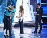 "<p>Eliminated contestant Haley Reinhart looks on as Scotty McCreery hugs Lauren Alaina as the two advance to the final of ""American Idol"", May 19, 2011. REUTERS/Michael Becker/FOX</p>"