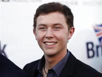 "<p>""American Idol"" television show contestant Scotty McCreery poses at the Royal Wedding themed champagne launch of BritWeek at the British Consul General's official Residence in Los Angeles, April 26, 2011. REUTERS/Danny Moloshok</p>"
