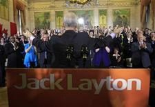 <p>New Democratic Party leader Jack Layton gestures after delivering a speech to his caucus on Parliament Hill in Ottawa May 24, 2011. REUTERS/Chris Wattie</p>