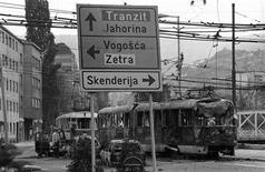<p>The wreckage of a tram stands in a street following shelling in the Skenderija district in Sarajevo March 1992. REUTERS/Danilo Krstanovic</p>
