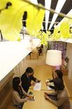 <p>Employees hold a meeting under a passion fruit leaves grown inside an office of Pasona Group, an employment and staffing company, during a photo opportunity in Tokyo October 20, 2010. REUTERS/Yuriko Nakao</p>