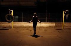 <p>Aspiring boxer Ryan Martins jumps rope during a training session at a gymnasium under the Alcantara Machado viaduct in the Mooca neighborhood of Sao Paulo, in this March 16, 2011 file photo. REUTERS/Nacho Doce</p>