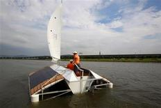 """<p>""""ForEver"""", a green vessel constructed entirely from recycled materials, sails after it maiden launch on World Oceans Day in Taipei June 8, 2011. REUTERS/Nicky Loh</p>"""