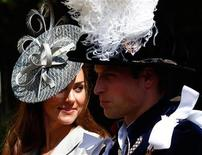 <p>Britain's Catherine, Duchess of Cambridge (L), sits next to her husband Prince William as they leave the Order of the Garter service at St. George's chapel inside the grounds of Windsor Castle, in Windsor, southern England, June 13, 2011. REUTERS/Andrew Winning</p>