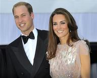 <p>Britain's Prince William and his wife Catherine, Duchess of Cambridge pose for photographers as they arrive for a charity dinner at Kensington Palace in London June 9, 2011. REUTERS/Toby Melville</p>