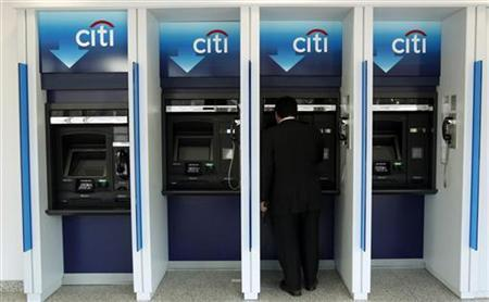 a man uses a citibank automated teller machine at a branch in washington january 19 2010 reutersjim young