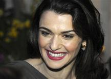 <p>British actress Rachel Weisz poses for photographers as she arrives to attend the 2010 Laurence Olivier awards in central London March 21, 2010. REUTERS/Jas Lehal</p>