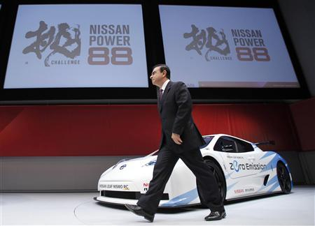Nissan Chief Executive Carlos Ghosn walks past in front of the company's Leaf Nismo RC, a prototype racing car based on Nissan Leaf, as he leaves at a news conference in Yokohama, south of Tokyo June 27, 2011. Nissan Motor Co. said on Monday it would aim for a global market share of 8 percent by the year ending in March 2017 and wants to boost its operating profit margin also to 8 percent in the same period. REUTERS/Yuriko Nakao
