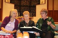 <p>Rebecca Over from England, Mary Ellen Schrock, of New York and Tina Becker, from Knoxville, Tennessee, try out a new Sacred Harp composition this year. REUTERS/Handout</p>