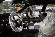 <p>A Chrysler Group LLC employee works on the assembly line during the production launch of Chrysler vehicles at the assembly plant in Brampton January 7, 2011. REUTERS/Mike Cassese</p>
