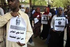 <p>Protesters made up of journalists and civilians hold pictures of Al Jazeera news network's cameramen Ali Hassan al-Jaber during a solidarity rally against the assassination of journalists, in Khartoum March 13, 2011. REUTERS/Mohamed Nureldin Abdallah</p>