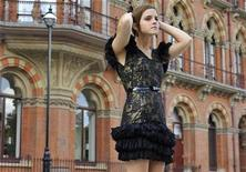 """<p>Emma Watson who plays Hermione in the Harry Potter series of films, poses for photographers outside the St Pancras Hotel in London July 6, 2011. The final Potter film, """"Harry Potter And The Deathly Hallows - Part II"""" will premiere in London on July 7. REUTERS/Toby Melville</p>"""