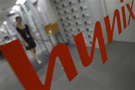 An employee of Hynix walks at the company's main office building in Seoul July 8, 2011. REUTERS/Truth Leem