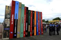 <p>Big cardboard books welcome visitors at the entrance of the XXIV Semana Negra (Noir Week) book fair in the northern Spanish town of Gijon July 25, 2011. REUTERS/Eloy Alonso</p>