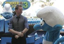 "<p>Cast member Neil Patrick Harris poses next to a smurf mascot during a photocall for his film ""The Smurfs"" in Cancun July 10, 2011.</p>"