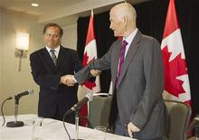 <p>New Democratic Party (NDP) leader Jack Layton shakes hands with NDP President Brian Topping (L) at a news conference in Toronto, July 25, 2011. REUTERS/Mark Blinch</p>