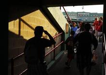 <p>Fans arrive for the MLB American League baseball game between the Kansas City Royals and the Boston Red Sox at Fenway Park in Boston, Massachusetts in this file image from July 27, 2011. REUTERS/Brian Snyder</p>