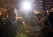 """<p>Leonardo DiCaprio signs autographs on the red carpet at the Japanese premiere of """"Inception"""" in Tokyo, July 20, 2010. REUTERS/Toru Hanai</p>"""