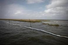 <p>An absorbent boom surrounds oiled marshland, one year after the BP Oil Spill, in Bay Jimmy near Myrtle Grove, Louisiana April 20, 2011. REUTERS/Lee Celano</p>