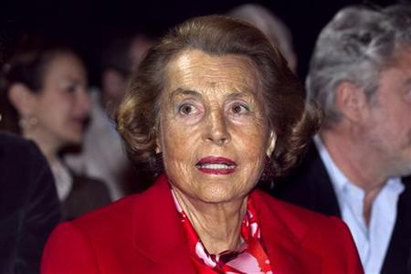 Liliane Bettencourt, heiress to the L'Oreal fortune, attends French designer Franck Sorbier's Haute Couture Spring-Summer 2011 fashion show in Paris January 26, 2011. REUTERS/Charles Platiau
