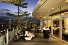 "<p>A view of ""Sky on 57"" restaurant at the Marina Bay Sands hotel and casino complex in Singapore in this undated publicity photo. Singaporean chef Justin Quek's new restaurant ""Sky on 57,"" which overlooks Singapore from the peak of a gleaming casino and hotel complex, is part of an influx of big-name chefs into the city-state as new money, proximity to Asia's growing economies, and slick tourist attractions draw businesses and visitors. REUTERS/Handout</p>"