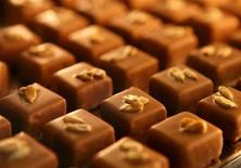 <p>Chocolates topped with sunflower seeds are displayed during the 2nd Chocolate Fair in Barcelona in this October 21, 2006 file photo. REUTERS/Albert Gea</p>