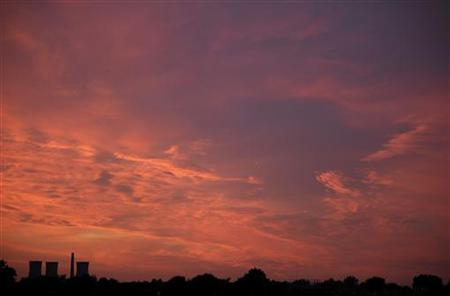 The sun sets over a disused power station in Ramsgate, southern England July 14, 2011. REUTERS/Dylan Martinez