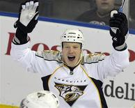 <p>Nashville Predator's Wade Belak celebrates a goal against the Edmonton Oilers during their NHL hockey game in Edmonton in this December 17, 2009 file photo. REUTERS/Dan Riedlhuber/Files</p>