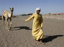 <p>An Omani trainer leads his camel as he prepares for the annual camel race in the Flaija race court in the south of Muscat March 22, 2011.REUTERS/Jamal Saidi</p>
