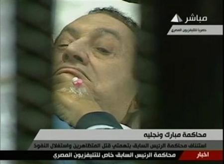 Former Egyptian President Hosni Mubarak is seen in the courtroom during his trial at the police academy in Cairo in this still image taken from video, August 15, 2011. REUTERS/Egypt TV via Reuters TV