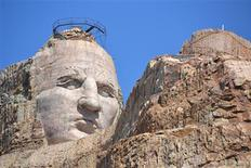 <p>The nearly 90-foot-tall carved granite face of Crazy Horse peers down on what will be the extended left arm and hand on the mountain carving in progress in South Dakota's Black Hills June 2, 2011. REUTERS/Pat Dobbs/Crazy Horse/Handout</p>