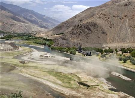 U.S. Chinook helicopters leave after a security handover ceremony in Panjshir province July 24, 2011. REUTERS/Ahmad Masood