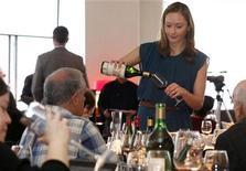 <p>Carlee Donohue, an employee of Acker Merrall & Condit, pours samples of rare wine at a rare wine auction at the restaurant Marea in New York March 19, 2011. REUTERS/ Mark Dye</p>