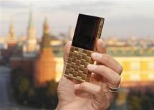 <p>Mathias Rajani, Danish luxury product company Aesir's chief commercial officer, holds a model of his company's new mobile phone during a press presentation in Moscow September 5, 2011. REUTERS/Sergei Karpukhin</p>