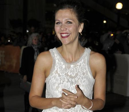 Cast member Maggie Gyllenhaal poses at the gala presentation for the film ''Hysteria'' at the 36th Toronto International Film Festival September 15, 2011. REUTERS/Mike Cassese