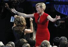 "<p>Actress Kate Winslet reacts after winning the Emmy award for outstanding lead actress in a miniseries or movie for ""Mildred Pierce"" at the 63rd Primetime Emmy Awards in Los Angeles September 18, 2011. REUTERS/Mario Anzuoni</p>"