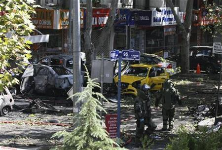 Turkish police bomb disposal experts walk at the site of a blast in central Ankara September 20, 2011. REUTERS/Stringer