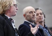 <p>The band R.E.M. with Mike Mills (L) who plays bass guitar, lead singer Michael Stipe (C) and Peter Buck, who plays guitar, are interviewed on the plaza of Rockefeller Center during the Today Show in New York April 1, 2008. REUTERS/Chip East</p>
