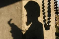 <p>The shadow of an Afghan National Army soldier and bullets are cast on the wall of a lookout tower in Kandahar province, southern Afghanistan, October 14, 2007. REUTERS/Finbarr O'Reilly</p>