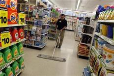 <p>A man sweeps the floor at a Dollar General store in a file photo. REUTERS/Rick Wilking</p>
