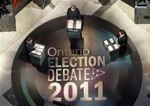 <p>Ontario Premier and Liberal leader Dalton McGuinty (L), provincial NDP leader Andrea Horvath (C) and provincial Conservative leader Tim Hudak participate in the provincial Ontario leaders debate in Toronto September 27, 2011. REUTERS/Mark Blinch</p>