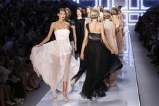 <p>Models present creations by Bill Gaytten for Dior at the end of his Spring/Summer 2012 women's ready-to-wear fashion collection show in Paris, September 30, 2011. REUTERS/Benoit Tessier</p>