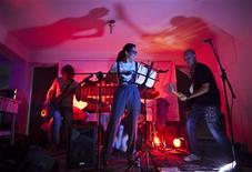 <p>Tears of the Sun, a rock band from Uzbekistan, performs during an underground pre-rock festival concert in Kabul September 27, 2011. REUTERS/Ahmad Masood</p>