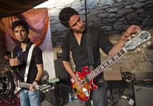 """<p>Afghan rock artistes tune their instruments during Sound Central, a one-day """"stealth festival"""" in Kabul October 1, 2011. REUTERS/Ahmad Masood</p>"""