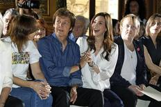 <p>Paul McCartney (2nd L) and Nancy Shevell (3rd L) attend Stella McCartney's Spring/Summer 2012 women's collection during Paris Fashion Week October 3, 2011. REUTERS/Benoit Tessier</p>
