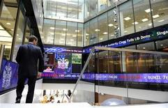 <p>A man walks down a staircase near a stock ticker in the lobby of the London Stock Exchange, in central London September 22, 2011. REUTERS/Paul Hackett</p>