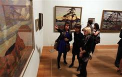 <p>Guests view paintings by Canadian artist Tom Thomson during the a show's opening at the Dulwich Picture Gallery in London October 17, 2011. The gallery is hosting Painting Canada: Tom Thomson and the Group of Seven from October 19, 2011 to January 8, 2012.REUTERS/Chris Helgren</p>