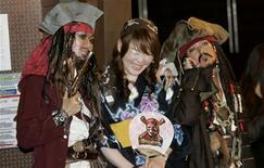 "<p>A woman takes a picture with participants who are dressed as ""Captain Jack Sparrow"", a character from ""Pirates of the Caribbean: At World's End"", at a costume event to promote the movie in Tokyo May 24, 2007. REUTERS/Kim Kyung-Hoon</p>"