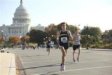 <p>Competitors run near the U.S. Capitol Building during the Marine Corps Marathon (MCM) through Washington in this October 25, 2009 handout photo courtesy of the United States Marine Corps. REUTERS/USMC/Cpl. Bryan G. Lett/Handout</p>